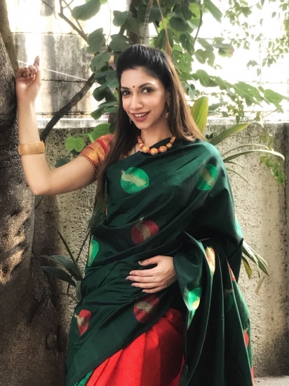 Green with red pallu and peacock motif