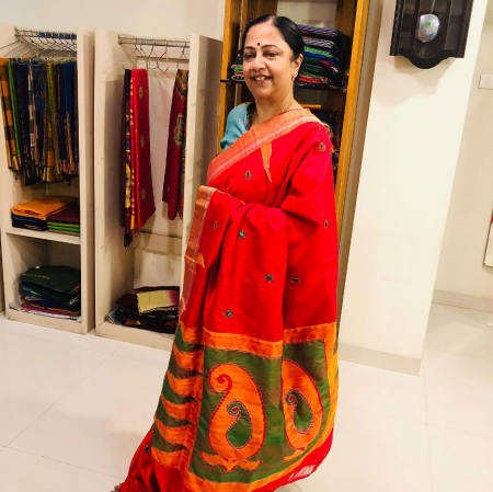 Red and green worki saree